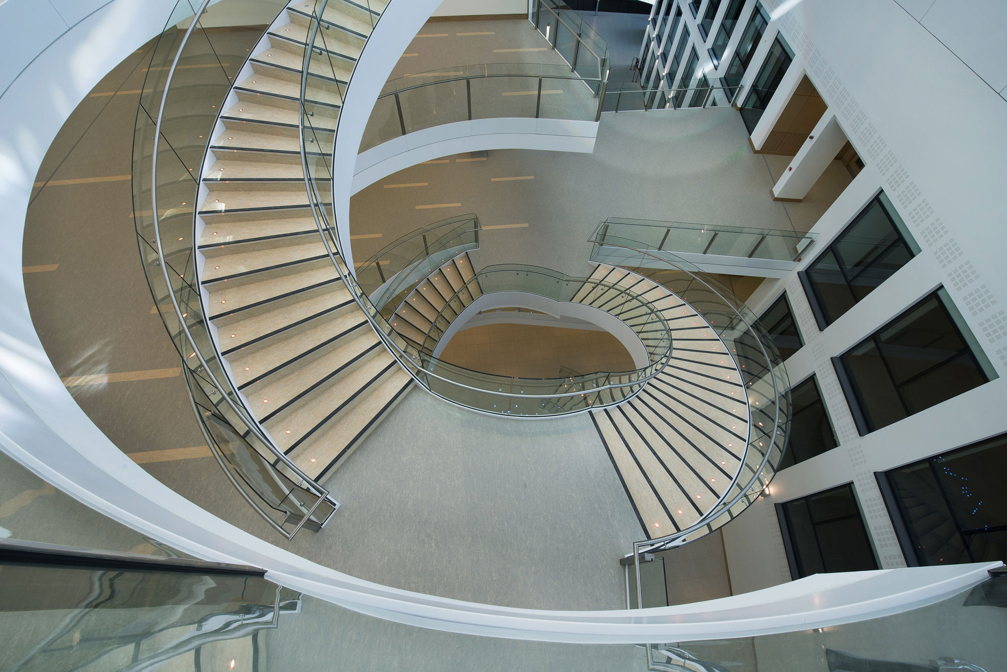Helical stairs structural glazing infills tsa for Architectural design services near me